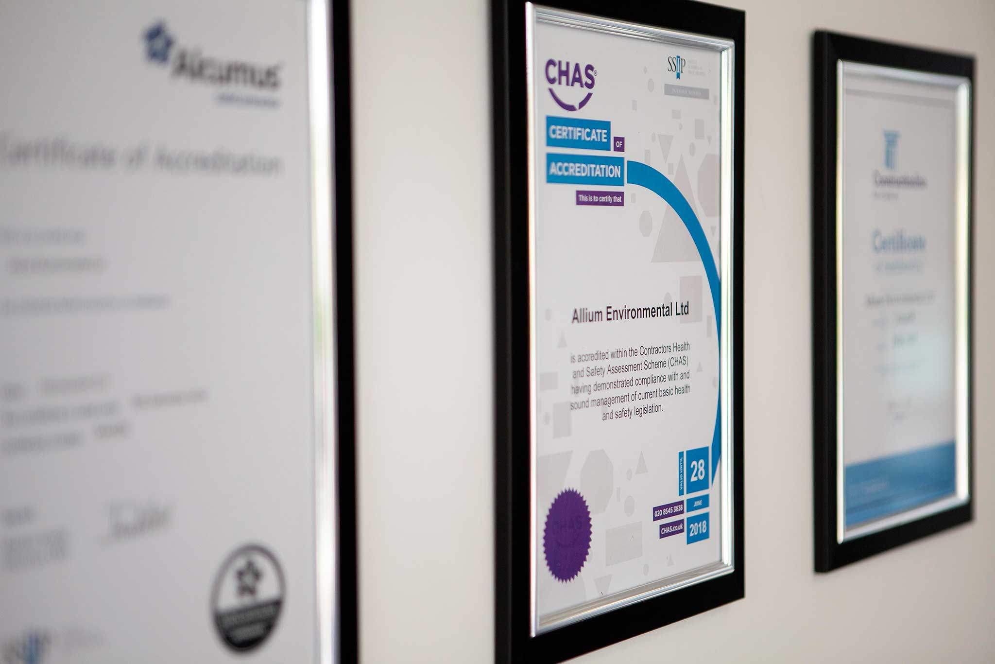 Asbestos Accreditation on the wall in Allium's head office in Cornwall