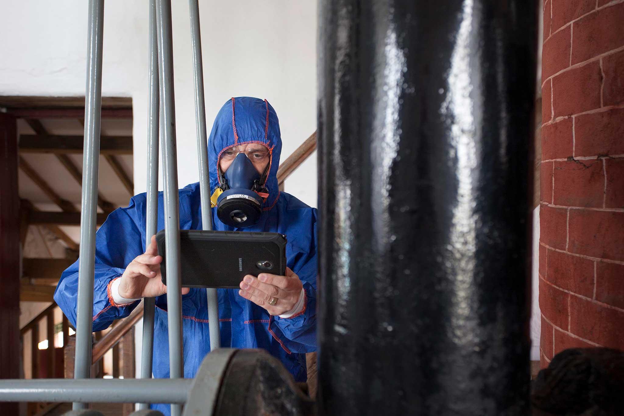Allium surveyor testing an old door for lead paint