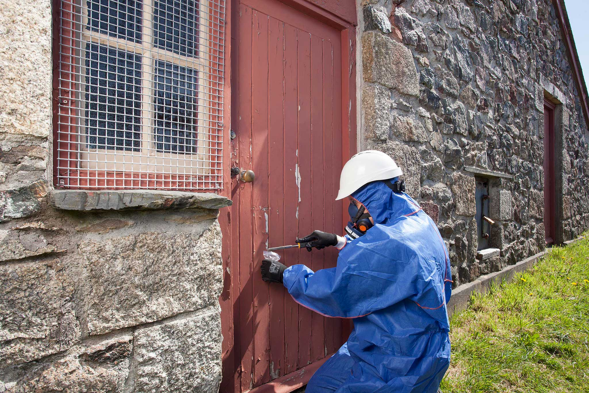 Allium surveyor testing an old door for lead paint