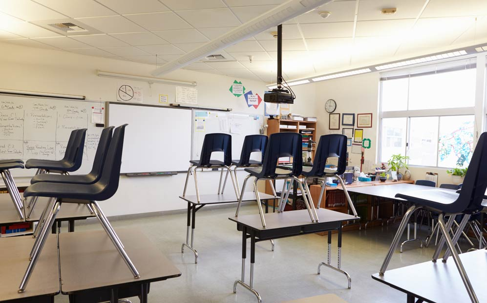 An empty classroom in a school with asbestos